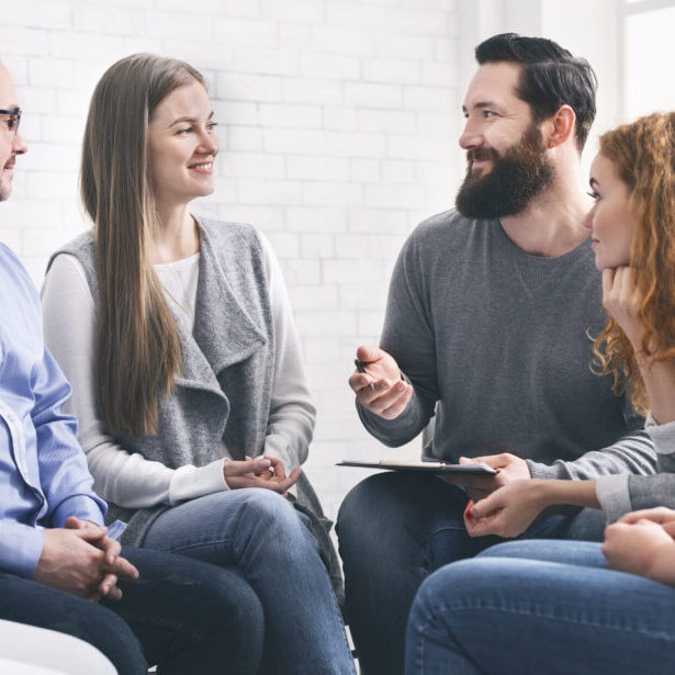 Professional help. Psychotherapist talking with patients during support group meeting, panorama